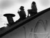 Lyon (Wes Charles, Jr.) & Curtis (Partap Khalsa) huddle on the rooftop